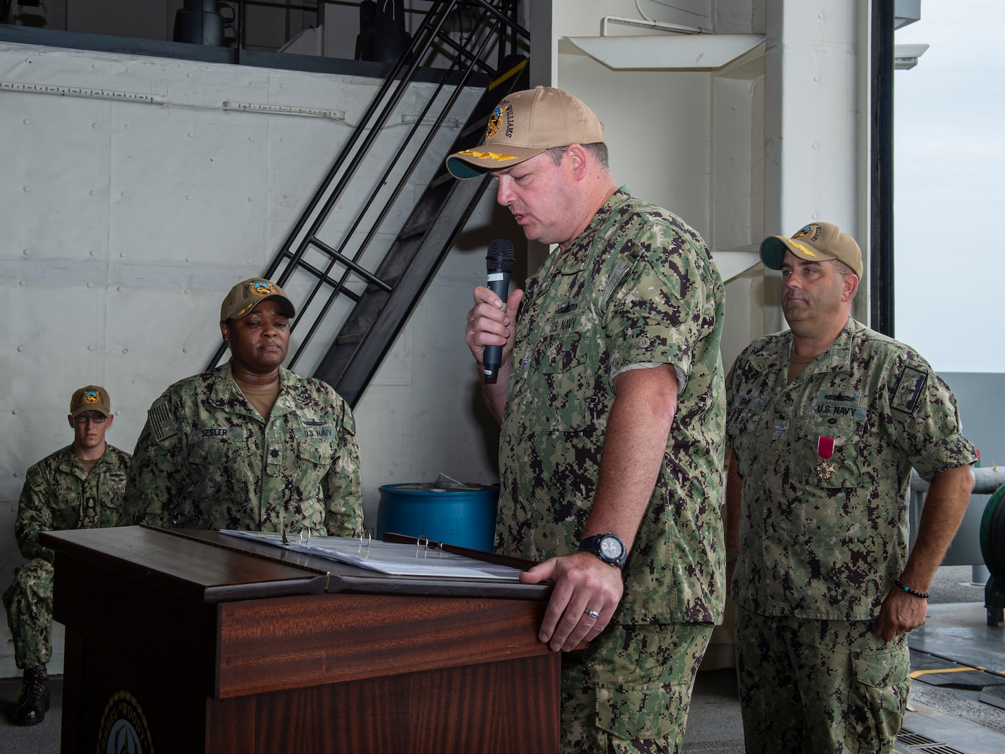 """Commanding Officer Chad Graham addresses his new crew following a change of command ceremony aboard the Expeditionary Sea Base USS Hershel """"Woody"""" Williams (ESB 4), July 25, 2021."""