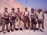 Lt. Col. Steve Wilson, 3rd from left, with his Mongolian counterparts in Iraq in 2004. Wilson was the first liaison to accompany the Mongolian Armed Forces on a deployment during the global war on terrorism as part of the State Partnership Program.