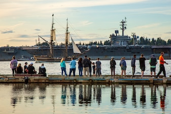 The aircraft carrier USS Theodore Roosevelt (CVN 71) arrives at Naval Base Kitsap in Bremerton, Washington as part of a homeport shift to conduct a docking planned incremental availability (DPIA) at Puget Sound Naval Shipyard & Intermediate Maintenance Facility.