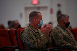 """Col. Neil T. Roeder, incoming commander, 3rd Medical Command Forward """"Desert Medics,"""" claps during a transfer of authority ceremony at Camp Arifjan, Kuwait, July 16, 2021. Roeder will lead the Detachment 10 unit here in theater."""