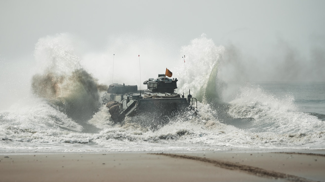 U.S. Marines with 2d Assault Amphibian Battalion (AABn.), 2d Marine Division, splash during a mechanized amphibious egress exercise on Camp Lejeune, N.C., July 22, 2021.  This training strengthened the unit's capacity to conduct amphibious training in the Atlantic while ensuring safety of operations. (U.S. Marine Corps photo by Cpl. Patrick King)