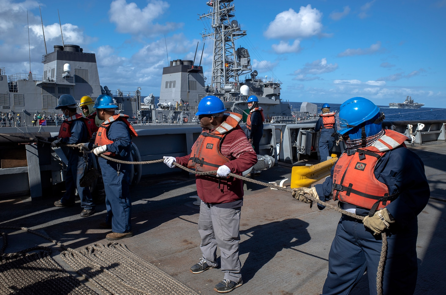 210722-N-N1109-007 CORAL SEA (July 25, 2021) - USNS Rappahannock (T-AO 204) crew members prepare to resupply JS Makinami (DD 112) during Exercise Talisman Sabre 21. This is the ninth iteration of Talisman Sabre, a large-scale, bilateral military exercise between Australia and the United States involving approximately 17,000 participants from seven nations. The month-long, multi-domain exercise consists of a series of training events that reinforce the strong U.S.-Australian alliance and demonstrate the U.S. military's unwavering commitment to a free and open Indo-Pacific. (Photo by Third Officer Brandon Feinberg)