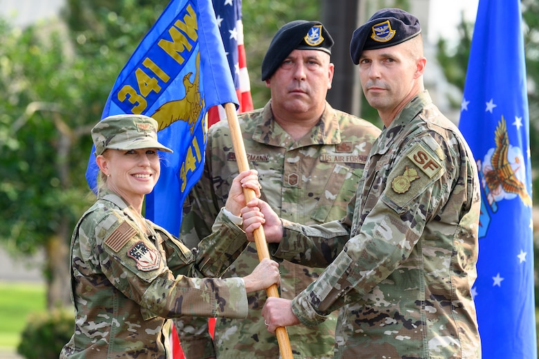 Col. Steven Bauman, right, accepts command of the 341st Security Forces Group from Col. Anita Feugate Opperman, 341st Missile Wing commander, during a change of command ceremony July 21, 2021, at Malmstrom Air Force Base, Mont.