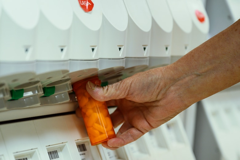 Sherry Morgan, 341st Operational Medical Readiness Squadron pharmacy technician, fills a prescription bottle July 14, 2021, at Malmstrom Air Force Base, Mont.