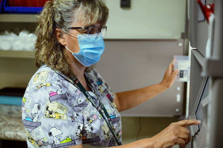 Sherry Morgan, 341st Operational Medical Readiness Squadron pharmacy technician, prepares a patient's prescription July 14, 2021, at Malmstrom Air Force Base, Mont.