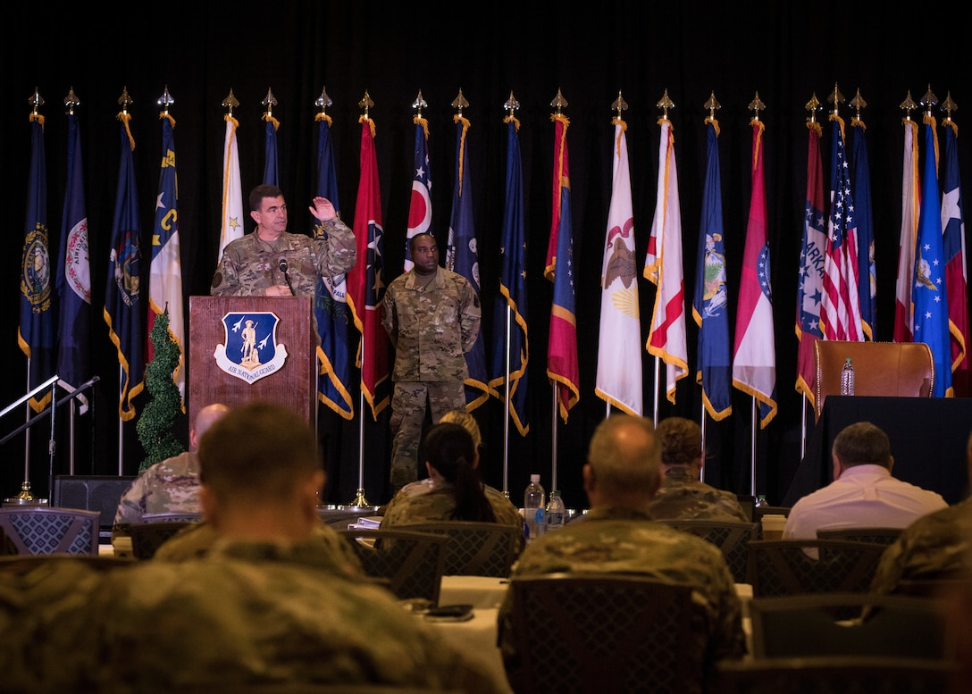 U.S. Air Force Lt. Gen. Michael A. Loh, left, director, Air National Guard, speaks during the closing ceremony of the 2021 Air National Guard Senior Leader Conference (ASLC) in St. Louis, Missouri, July 22, 2021. ASLC 21 joins together senior leaders and commanders from across the 90 wings to exchange ideas and provide input on critical matters that impact the future of the enterprise. (U.S. Air National Guard photo by Tech. Sgt. Morgan R. Whitehouse)
