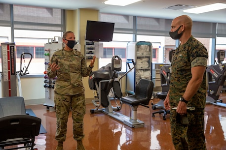 The 19th Sergeant Major of the Marine Corps, Sgt. Maj. Troy E. Black, tours the Brooke Army Medical Center, San Antonio, Texas, July 20, 2021. The Sergeant Major of the Marine Corps conducted the tour to get an update on the research and recovery facilities that support Wounded Warrior Battalion-East, San Antonio detachment. Wounded Warrior Battalion supports recovery, and non-medical care of combat and non-combat wounded, ill, and injured Marines, and sailors attached to Marine units, and their family members in order to maximize their recovery as they return to duty or transition to civilian life. (U.S. Marine Corps photo by Sgt. Victoria Ross)