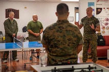 The 19th Sergeant Major of the Marine Corps, Sgt. Maj. Troy E. Black, addresses Marines at the Wounded Warrior Battalion-East, San Antonio detachment at the Brooke Army Medical Center, San Antonio, Texas, July 20, 2021. The Sergeant Major of the Marine Corps spoke to the Marines and staff to share with them his perspective as the senior most enlisted Marine in the Marine Corps. Wounded Warrior Battalion supports recovery, and non-medical care of combat and non-combat wounded, ill, and injured Marines, and sailors attached to Marine units, and their family members in order to maximize their recovery as they return to duty or transition to civilian life. (U.S. Marine Corps photo by Sgt. Victoria Ross)