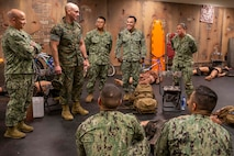 The 19th Sergeant Major of the Marine Corps, Sgt. Maj. Troy E. Black, addresses sailors at the Navy Medicine Training Support Center, Fort Sam Houston, San Antonio, Texas, July 21, 2021. The Sergeant Major of the Marine Corps spoke to the Sailors to share with them his perspective as the senior most enlisted Marine in the Marine Corps. The Navy Medicine Training Support Center (NMTSC) is the Navy component command that provides administrative and operational control over Navy staff and students assigned to the Medical Education & Training Campus (METC) and other medical programs in the San Antonio area. (U.S. Marine Corps photo by Sgt. Victoria Ross)