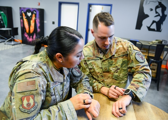 Tech. Sgt. Carmen Turcios Munoz, Ellington Airman Leadership School instructor, shows off a smart watch which provides Airmen biofeedback to improve physical exercise, their sleep, their timing of when to tackle which tasks and other benefits. (Air Force photo by Gary Hatch)