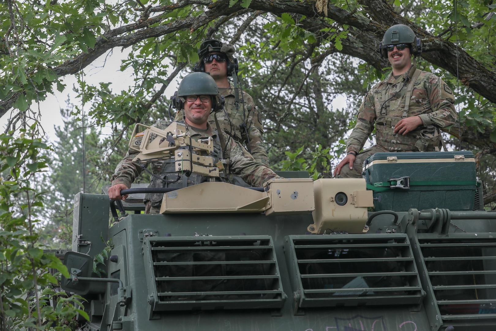 HIMARS crew members in the 1-147th Field Artillery Battalion, South Dakota National Guard, conduct annual training, waiting for orders inside their M270A1 MLRS at Camp Ripley Training Center in Minnesota July 15, 2021. The main mission of the 1-147th FA is to deliver precision fire on enemies.