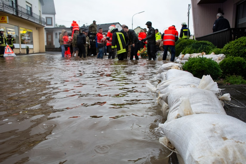 People place sandbags during a flood.