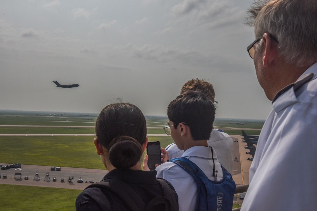 People look at aircraft taking off