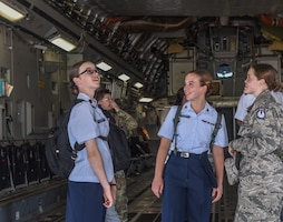 Girls look at inside of aircraft
