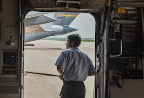 Boy looks out of aircraft