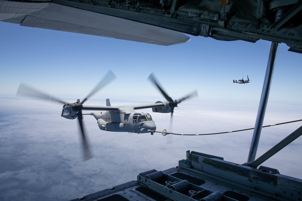 U.S. Marine Corps MV-22B Osprey's with Marine Aircraft Group 16, 3rd Marine Aircraft Wing (MAW), conduct air to air refueling operations during Marine Corps training exercise Summer Fury 21 at Marine Corps Air Station Miramar, California, July 7, 2021. The importance of aerial refueling is to extend the range of an aircraft's ability to remain in the air and combat effective during maritime operations, especially in coastal regions, which will be contested and dangerous, compelling the Marine Corps to operate in an increasingly dispersed manner. Summer Fury is an exercise conducted by 3rd MAW in order to maintain and build capability, strength and trust within its units to generate the readiness and lethality needed to deter and defeat adversaries during combat operations as the U.S. Marine Corps refines tactics and equipment in accordance with Force Design 2030. (U.S. Marine Corps photo by Lance Cpl. Quince Bisard)