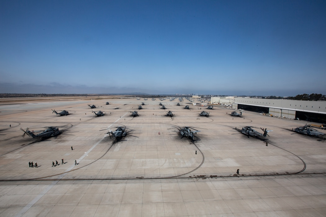 U.S. Marine Corps CH-53E Super Stallions with Marine Aircraft Group (MAG) 16, 3rd Marine Aircraft Wing (MAW), prepare to take off at Marine Corps Air Station Miramar, California, July 14, 2021. In a dynamic display of combat power that featured over 40 aircraft in MAG-16's mass flight, the aircraft showcased the tactical capabilities that 3rd MAW uses to remain lethal and deployable on a moment's notice. (U.S. Marine Corps photo by Cpl. Nicolas Atehortua)