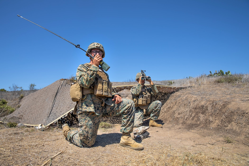 U.S. Marine Corps Lance Cpl. Chandler G. Bryan (left), and Lance Cpl. Dante G. Mannarino, low altitude air defense gunners with Alpha Company, 3rd Low Altitude Air Defense (LAAD) Battalion, Marine Air Control Group 38, 3rd Marine Aircraft Wing (MAW), radio to their command a spotted notional enemy aircraft during the Anti-aircraft Warfare evolution of Summer Fury 21 at San Clemente Island, July 21, 2021. 3rd LAAD is responsible for providing close-in, low altitude, and surface to air defense against enemy aircraft that approach Marine Corps forward combat areas, maneuver forces and vital installations. Summer Fury is an exercise conducted by 3rd MAW in order to maintain and build capability, strength, and trust within its units to generate the readiness and lethality needed to deter and defeat adversaries during combat operations as the U.S. Marine Corps refines tactics and equipment in accordance with Force Design 2030. (U.S. Marine Corps photo by Lance Cpl. Quince Bisard)