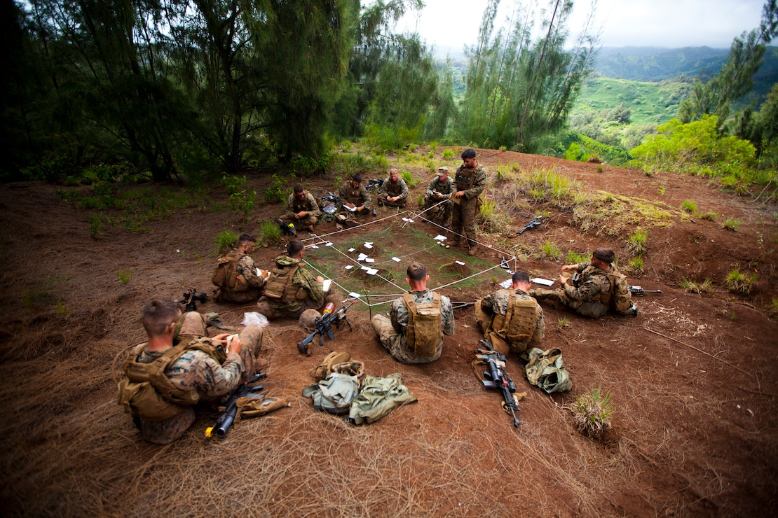 U.S. Marine Corps infantry squad leaders assigned to School of Infantry West, Detachment Hawaii, use a terrain model during the Advanced Infantry Course aboard Kahuku Training Area, Hawaii, July 20, 2016. AIC is intermediate training designed to enhance and test the Marine's skills and leadership abilities as squad leaders in a rifle platoon.