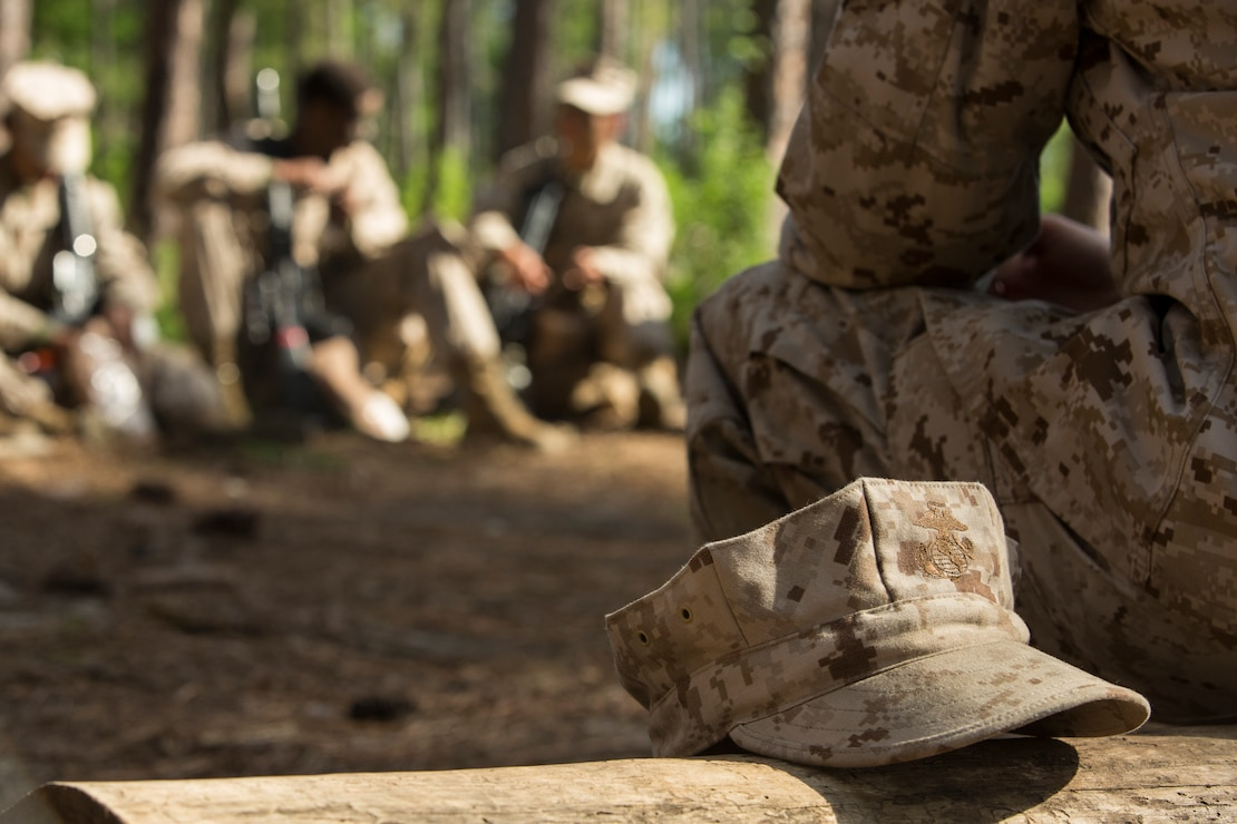 U.S. Marine Corps Staff Sgt. Jade Nichols, a senior drill instructor with Papa Company, 4th Recruit Training Battalion, discusses reasons for joining the Marine Corps with her recruits during the Crucible at Parris Island, S.C. April 20, 2018. The four phase recruit training model, implemented in November 2017, allows the drill instructors the opportunity to transition to a role of coach and mentor.
