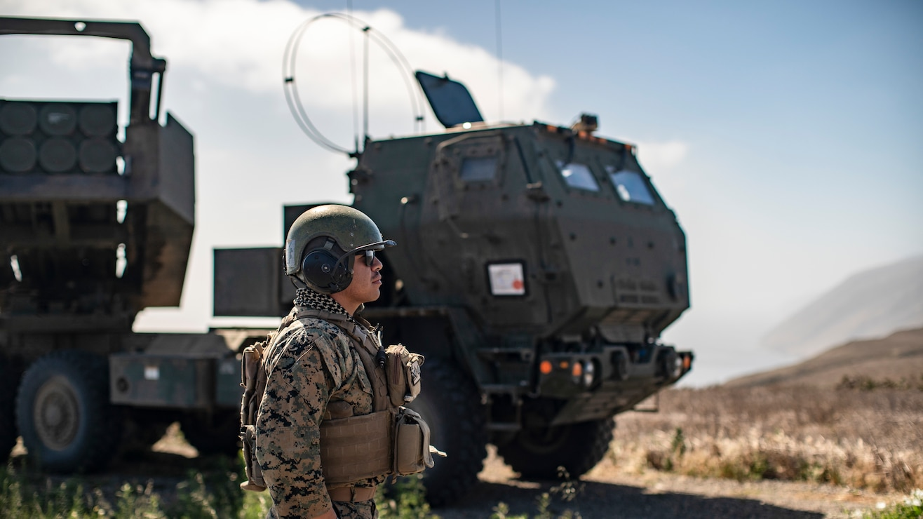 U.S. Marine Corps Sgt. Elias Munoz, a launcher chief with Bravo Battery, Battalion Landing Team 1/1, 11th Marine Expeditionary Unit, prepares a High Mobility Artillery Rocket System for a simulated long-range strike mission at San Clemente Island, Calif., May 20, 2021. The Battery went ashore in support of an expeditionary advanced basing exercise, targeting simulated enemy on the island, and enemy vessels nearby. The Marines and Sailors of the 11th MEU and Essex Amphibious Ready Group are conducting routine training off the coast of southern California.