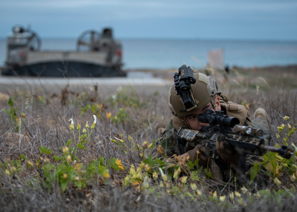 U.S. Marine Corps Pfc. Jacob Gastelum, a rifleman with Alpha Company, Battalion Landing Team 1/1, 11th Marine Expeditionary Unit, holds security for an amphibious landing as part of an expeditionary advance base exercise, May 15. Marines and Sailors of the 11th MEU and Essex Amphibious Ready Group are conducting integrated training on and off the coast of southern California.