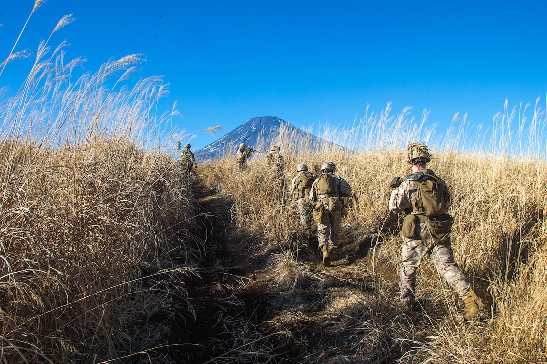 U.S. Marines with Kilo Company, 3rd Battalion, 8th Marine Regiment, patrol at Combined Arms Training Center, Camp Fuji, Japan, Jan. 21, 2021. Marines patrolled in disaggregated units towards a common objective for Joint Exercise Littoral Strike, the culminating event for Fuji Viper 21.2, that strengthened interoperability and challenged infantry formations to facilitate joint force multi-domain maneuver in support of naval operations. 3/8 is forward-deployed in the Indo-Pacific under 4th Marine Regiment, 3rd Marine Division.