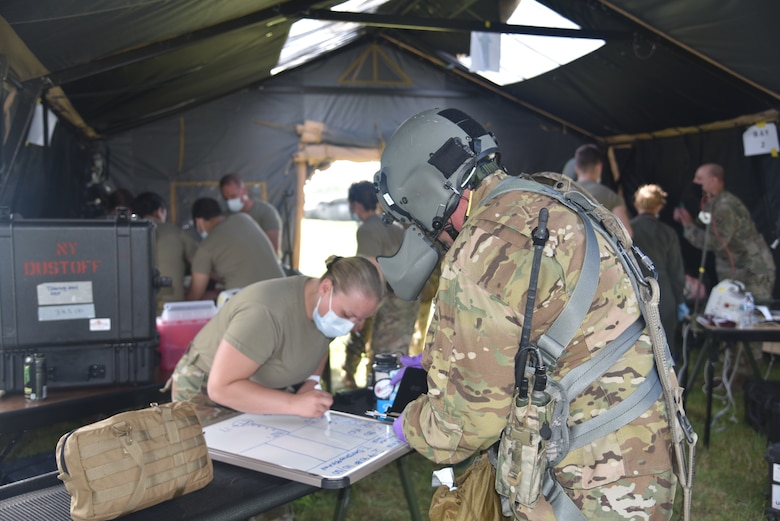 New York airmen and soldier conducted a joint medical training operation at Hancock Field Air National Guard base, Syracuse, N.Y. Soldiers from 171st General Aviation Support Battalion and the 174th Medical Group worked together to refresh their medical skills during a simulated environment. The training event included a medical evacuation in a UH-60 Black Hawk helicopter, handoff to medics on the ground to a medical tent.. (U.S. Air National Guard photo by Master Sgt. Barbara Olney)