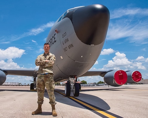 U.S. Air Force Tech. Sgt. Cody Plopper, a KC-135 Stratotanker aircraft crew chief with the 927th Air Refueling Wing, MacDill Air Force Base, Florida, stands in front of a KC-135 on the flight line July 10, 2021. Plopper was recently named as Air Force Reserve Command's Crew Chief of the Year. (U.S. Air Force photo by Staff Sgt. Tiffany A. Emery)