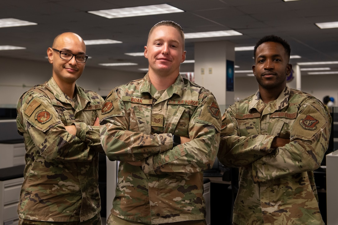 U.S. Air Force Airman 1st Class Pedro Andrada, left, Tech. Sgt. Joshua Boak, and Airman 1st Class Devin Moone, all assigned to the 36th Contracting Squadron, pose for a photo at Andersen Air Force Base, Guam, July 22, 2021. The 36th CONS team recently awarded two contracts worth a total of $64,000 to provide the Cook Islands with medical supplies needed for COVID-19 relief. The purchase consisted of medical supplies such as syringes, masks, gloves, blood administration sets, shoe covers and other necessary equipment.