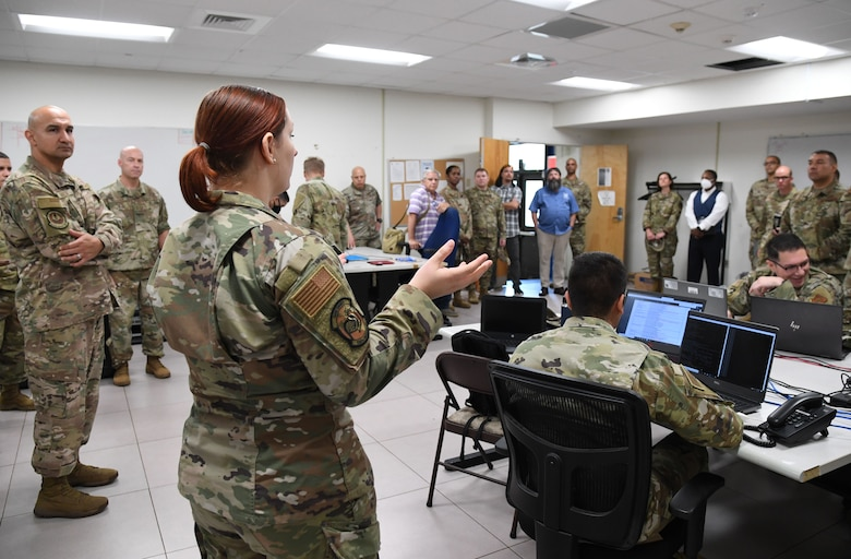 U.S. Air Force Tech. Sgt. Emily Sloan, 338th Training Squadron instructor, provides a cyber transport course briefing inside Bryan Hall at Keesler Air Force Base, Mississippi, July 21, 2021. The 81st Training Support Squadron hosted the Cyber Operations Specialty Training and Requirements Team Conference for cyber operations career field managers and MAJCOM functional managers July 19-23. (U.S. Air Force photo by Kemberly Groue)