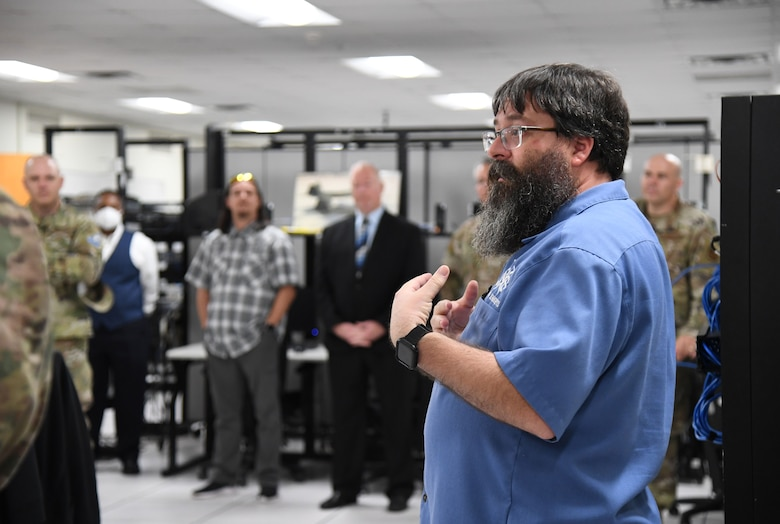Bill Collum, 338th Training Squadron training manager, provides a tour and briefing on 338th TRS courses inside Bryan Hall at Keesler Air Force Base, Mississippi, July 21, 2021. The 81st Training Support Squadron hosted the Cyber Operations Specialty Training and Requirements Team Conference for cyber operations career field managers and MAJCOM functional managers July 19-23. (U.S. Air Force photo by Kemberly Groue)