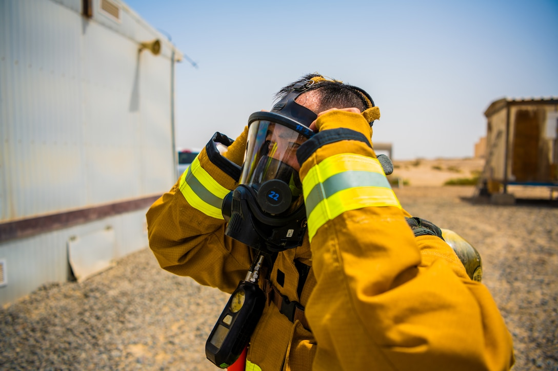 U.S. Air Force Airmen of the 380th Expeditionary Fire Department, conducts an exercise with base leadership at Al Dhafra Air Base, United Arab Emirates, July 24, 2021.