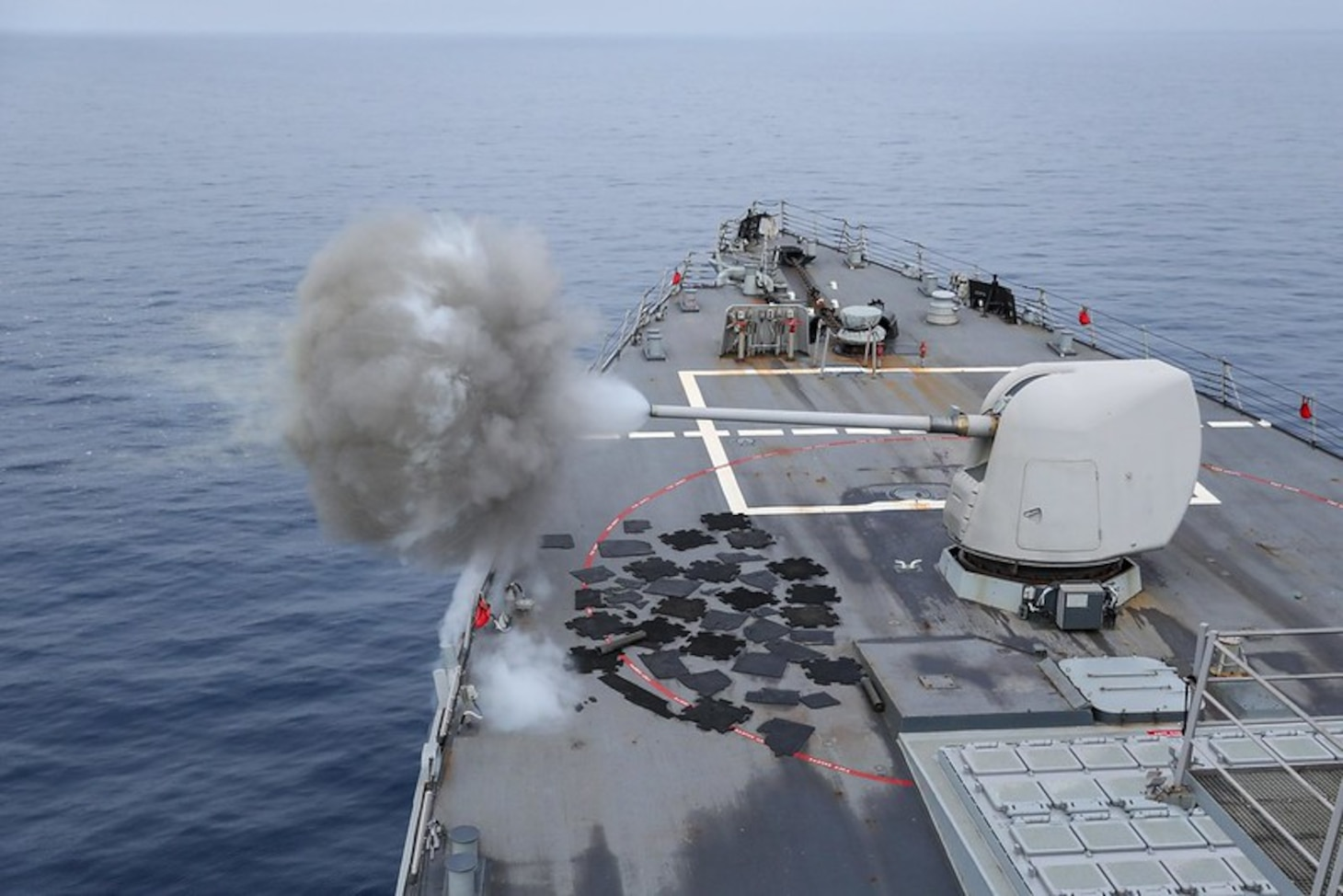 The Arleigh Burke-class guided-missile destroyer USS Ross (DDG 71) fires its Mark 45 5-inch gun while underway in the Mediterranean Sea, July 22, 2021.
