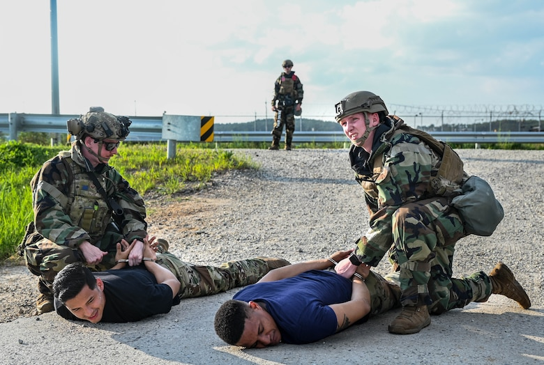 Airman arrest simulated perpetrators.