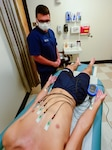 Health care professionals from the U.S. Coast Guard Auxiliary Health Services and U.S. Coast Guard Academy Clinic performed electrocardiograms on the Swabs in the Class of 2025, July 5, 2021. The new ECG screening program aims to mitigate the chances of students experiencing a sudden cardiac arrest. (U.S. Coast Guard courtesy photo by David Kenny)
