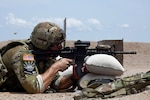 Army Staff Sgt Stephen Southerlin II, an infantryman with the Texas Army National Guard's C Troop, 1st Battalion, 124th Regiment, fires an M4 Carbine rifle during the rifle challenge portion of the 2021 Army National Guard Best Warrior Competition at Camp Navajo, Arizona, July 20, 2021. The competition spans three physically and mentally demanding days where competitors are tested on a variety of tactical and technical skills as they vie to be named the Army Guard's Soldier and Noncommissioned Officer of the Year. The winners then represent the Army Guard in the Department of the Army Best Warrior Competition later this year.