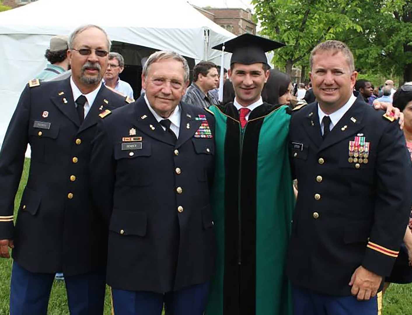 Fahim Masoud, second from right, graduated from Washington University in St. Louis, Missouri. Among those in attendance was retired Iowa Army National Guard CW3 James Ditter, right. Ditter sponsored Masoud to the United States on a student visa.