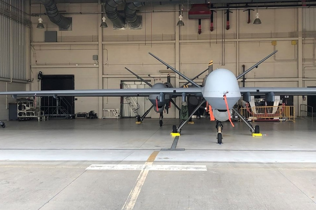 Two 147th Attack Wing MQ-9 Reapers are prepped and ready in  a hangar at Ebbing Air National Guard Base, Ark. during joint exercise Establish Fury. The exercise demonstrates the Wing's Immediate Reaction Force feasibility using the Agile Combat Employment concept.