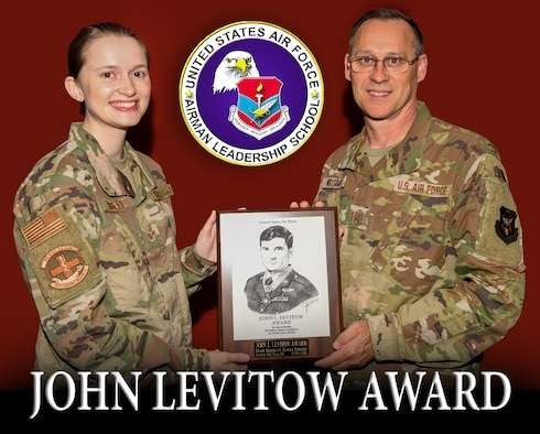 Chief Master Sgt. Christopher Williams, 445th Airlift Wing command chief, presents the John L. Levitow Award to Staff Sgt. Kayla Liggett, 445th Aerospace Medicine Squadron health services management technician, July 11, 2021 for her performance during a virtual Airman Leadership School conducted at Hanscom Air Force Base, Maine.