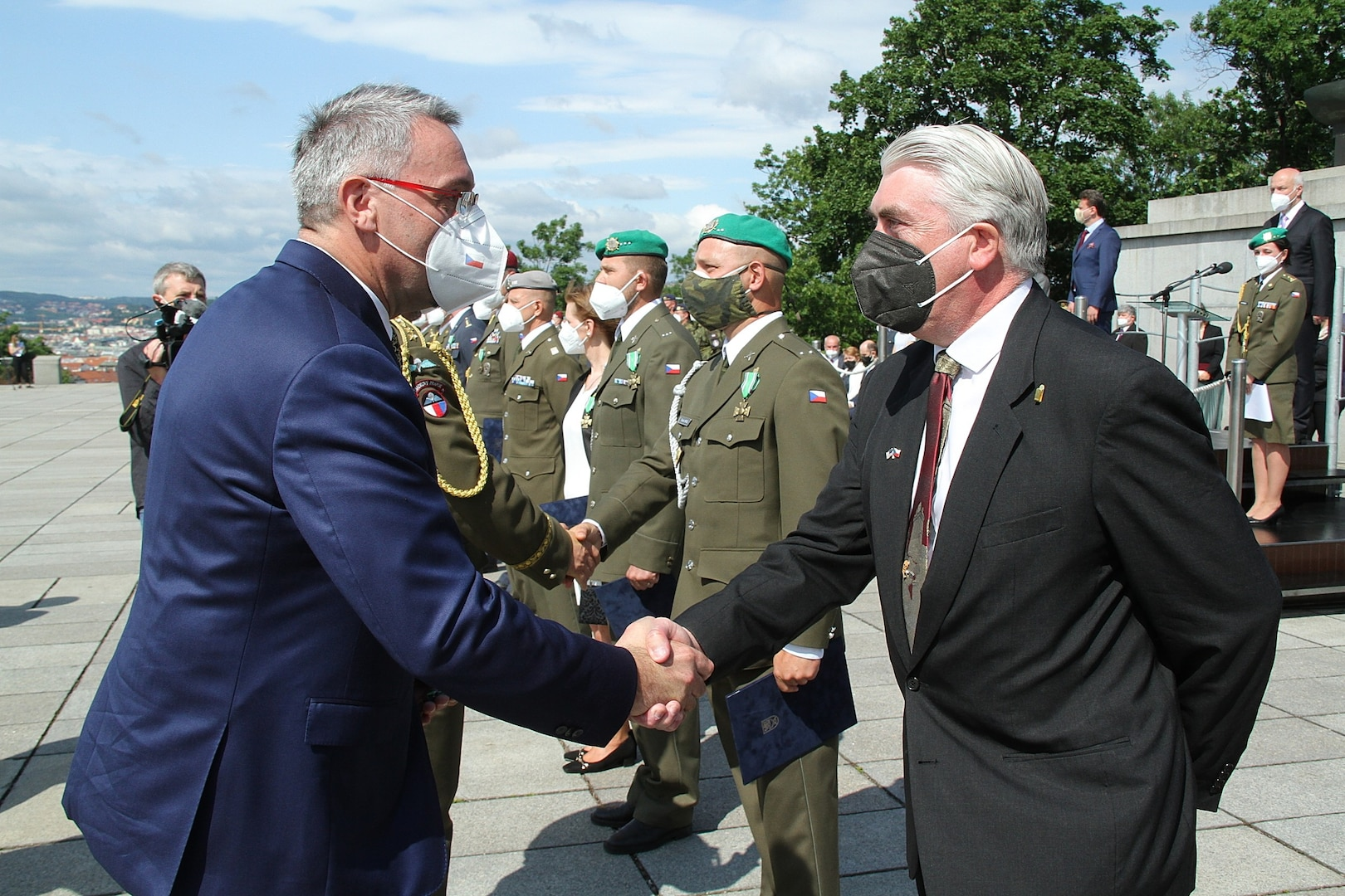 Czech Republic Minister of Defence, Lubomir Metna, greeting Dr. Stephen D. O'Regan.