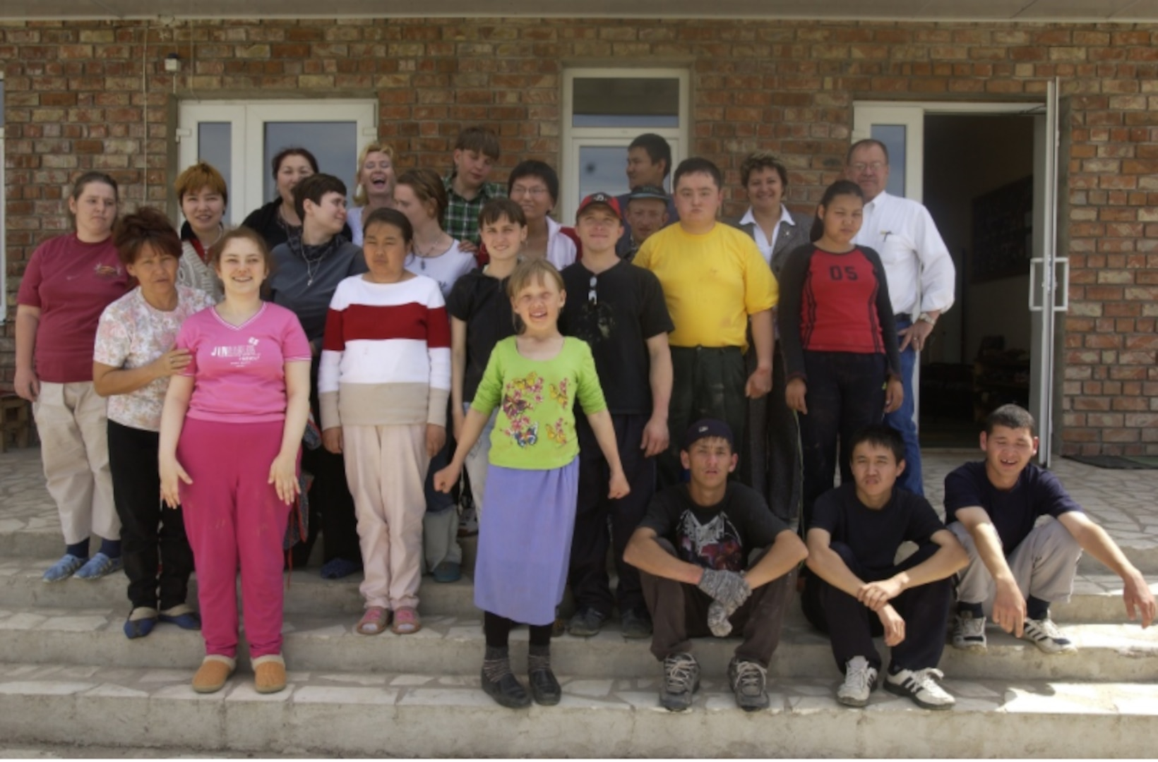 Students and staff line up for a picture in front of the Uventus Center outside of Bishkek, Kyrgyzstan. The school teaches work skills to special needs children.