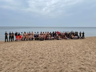 United States Marine Corps recruiters with Recruiting Station Lansing, lead a high-intensity, beach workout with local high school athletes at Pere Marquette Park, Muskegon, Michigan, July 16, 2021. The recruiters created this workout to challenge the personal preconceived limitations of the participants. (U.S. Marine Corps photo by Cpl. Jesse Carter-Powell)