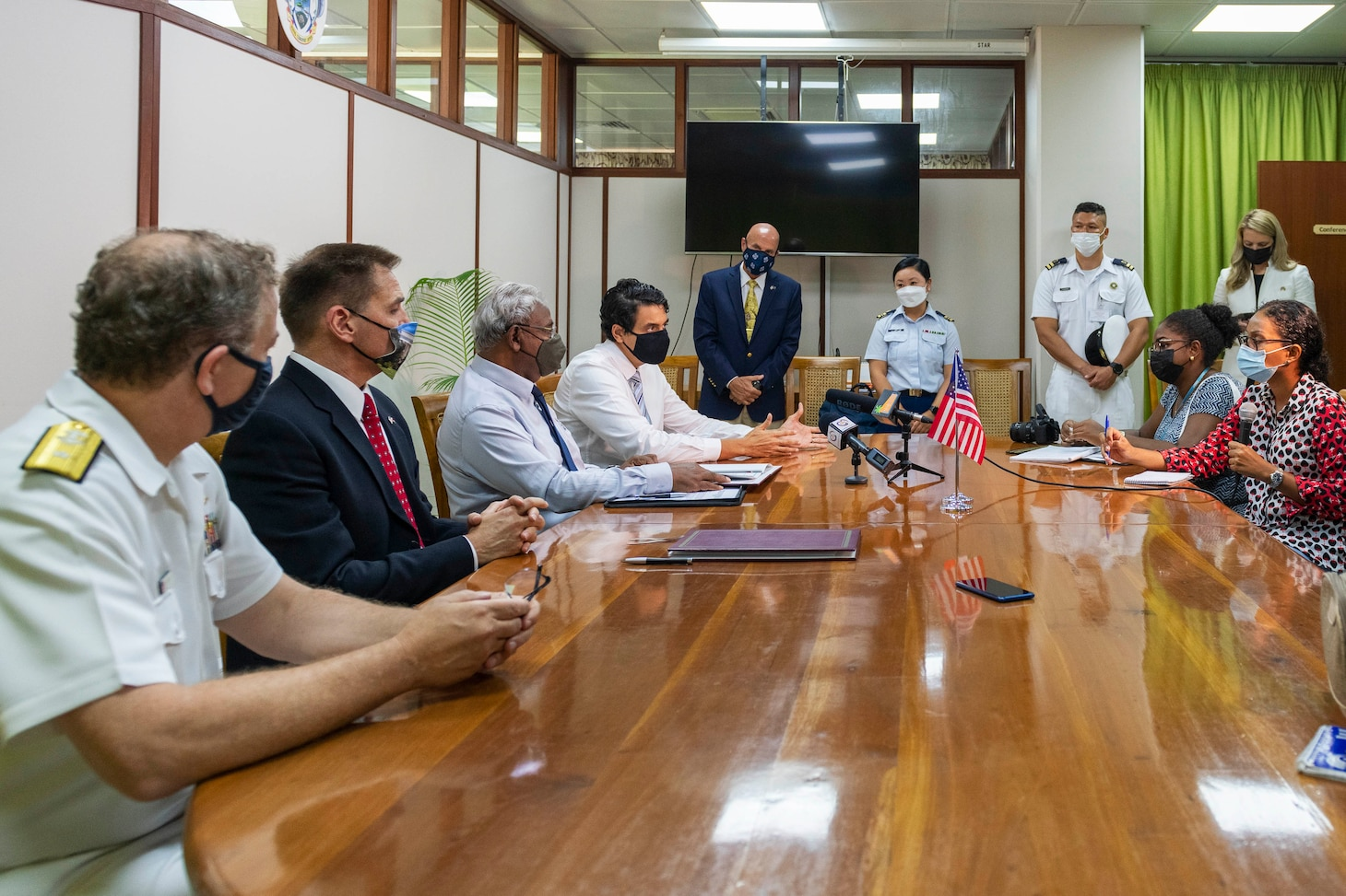 (July 27, 2021) Rear Adm. Jeffrey Spivey, director, Maritime Partnership Program, U.S Naval Forces Europe-Africa, left, U.S. Embassy Acting Deputy Chief of Mission Thom Kohl, center left, and Seychelles Minister for Internal Affairs, Errol Fonseka, attends the official signing of the bilateral agreement between the United States and Seychellois Governments on Countering Illicit Transnational Maritime Activity Operations in conjunction with exercise Cutlass Express 21, July 27, 2021 at the Independence House Annex in Seychelles. This is the first bilateral maritime Agreement between the United States and an East African country.
