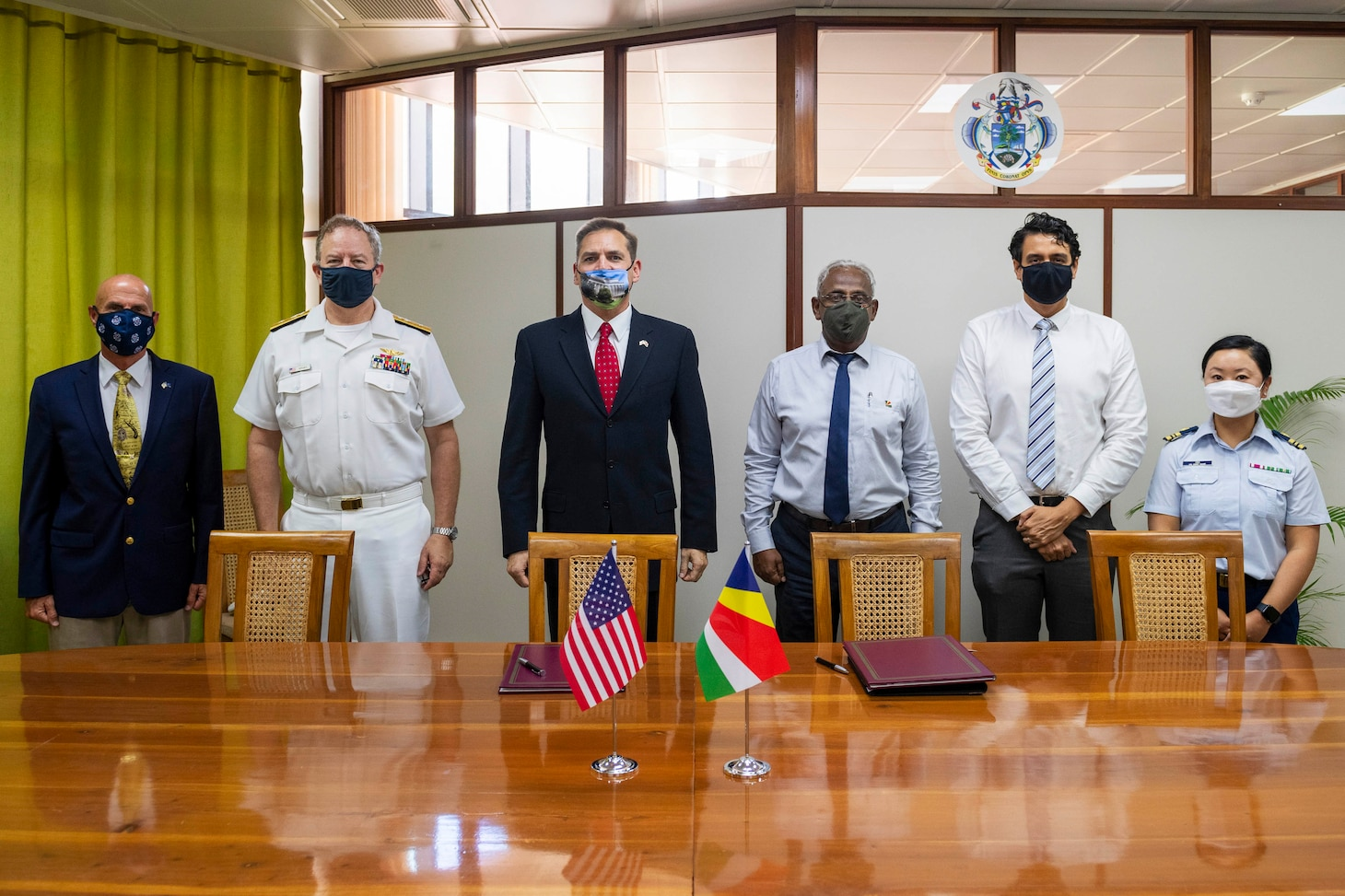 (July 27, 2021) Rear Adm. Jeffrey Spivey, director, Maritime Partnership Program, U.S Naval Forces Europe-Africa, second from left, U.S. Embassy Acting Deputy Chief of Mission Thom Kohl, center, and Seychelles Minister for Internal Affairs, Errol Fonseka, pose for a photo during the official signing of the bilateral agreement between the United States and Seychellois Governments on Countering Illicit Transnational Maritime Activity Operations in conjunction with exercise Cutlass Express 21, July 27, 2021 at the Independence House Annex in Seychelles. This is the first bilateral maritime Agreement between the United States and an East African country.