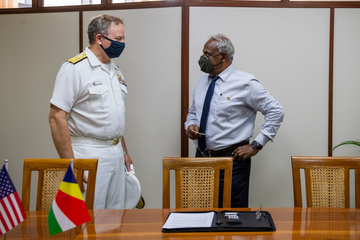 (July 27, 2021) Rear Adm. Jeffrey Spivey, director, Maritime Partnership Program, U.S Naval Forces Europe-Africa, left, and Seychelles Minister for Internal Affairs, Errol Fonseka, talk during the official signing of the bilateral agreement between the United States and Seychellois Governments on Countering Illicit Transnational Maritime Activity Operations in conjunction with exercise Cutlass Express 21, July 27, 2021 at the Independence House Annex in Seychelles. This is the first bilateral maritime Agreement between the United States and an East African country.