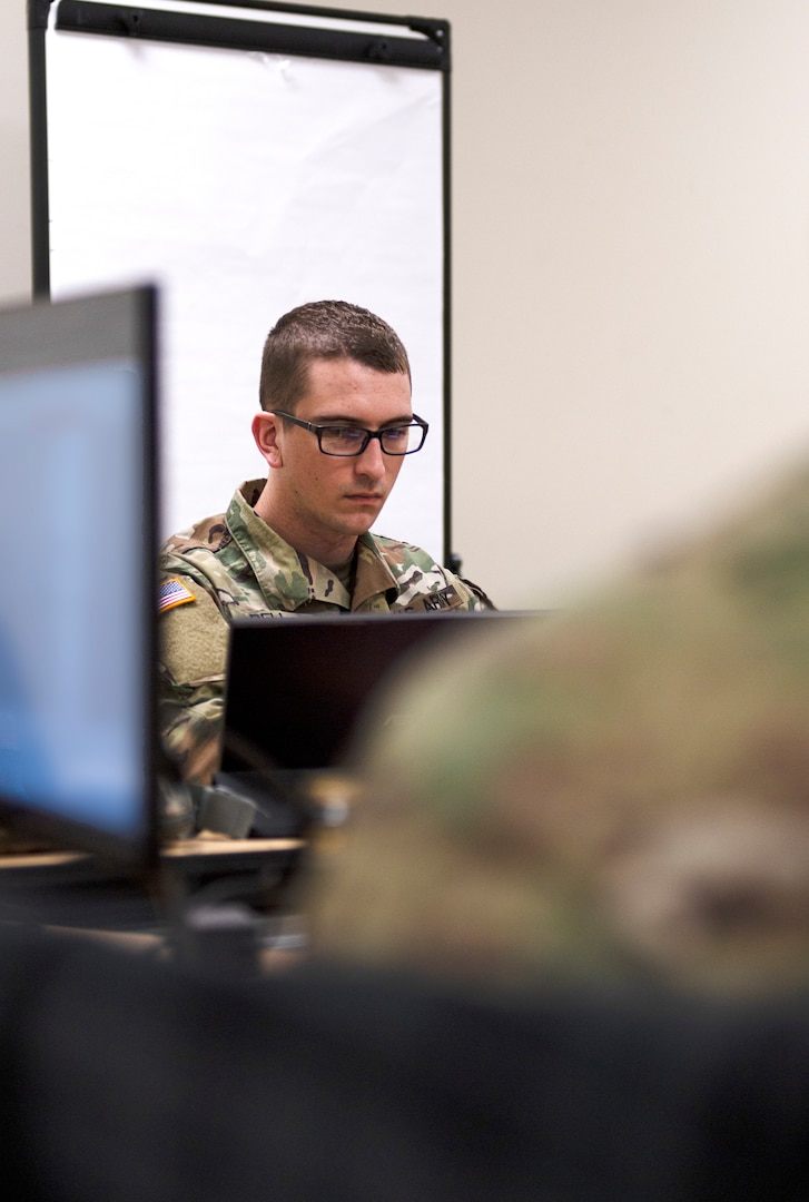 Spc. James Bell, cable systems installer, 45th Infantry Brigade Combat Team, Oklahoma Army National Guard, serves as part of the host team for the cyber operations team during Cyber Shield 2021 at the Armed Forces Reserve Center, Norman, Oklahoma, July 21, 2021. Cyber Shield is an annual training exercise focused on identifying and defending against cyber threats that compromise local and national security.   (Oklahoma National Guard photo by Sgt. 1st Class Mireilie Merilice-Roberts)
