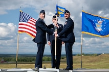 U.S. Air Force Col. Matthew Powell, (left), the 354th Maintenance Group commander, and Lt. Col. Cory Helms, the 354th Munitions Squadron commander, pose for a photo during an assumption of command ceremony on Eielson Air Force Base, Alaska, July 26, 2021.
