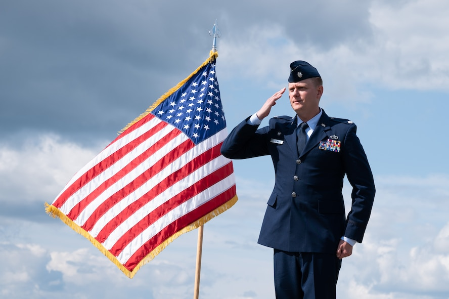 U.S. Air Force Lt. Col. Cory Helms, the 354th Munitions Squadron commander, renders the first squadron salute during an assumption of command ceremony on Eielson Air Force Base, Alaska, July 26, 2021.