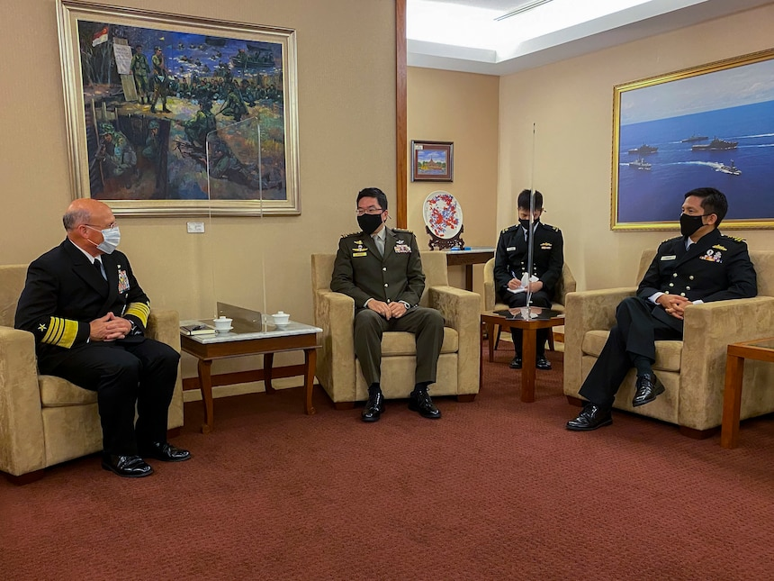 SINGAPORE (July 26, 2021) - Chief of Naval Operations (CNO) Adm. Mike Gilday meets with Chief of Defence Force, Singapore Armed Forces Lieutenant-General Melvyn Ong and Chief of Navy, Republic of Singapore Navy Rear Adm. Aaron Beng during a trip to the region. Gilday visited the region to meet with senior military and government leadership to reaffirm the U.S. Navy's commitment to our partners and allies and help keep the seas open and free.(U.S. Navy photo by Cmdr. Nate Christensen/Released)